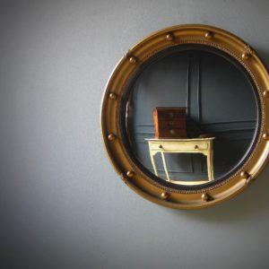 Antique convex gilt mirror