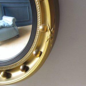 Gilt antique convex mirror