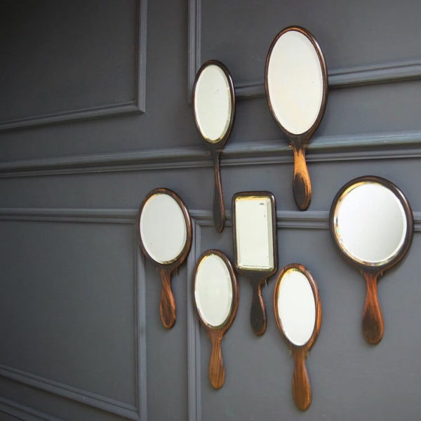 collection of antique hand mirrors