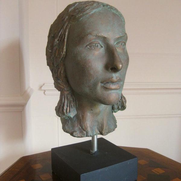 Interesting faux bronze head