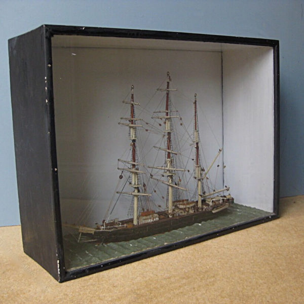 antique ship in a case
