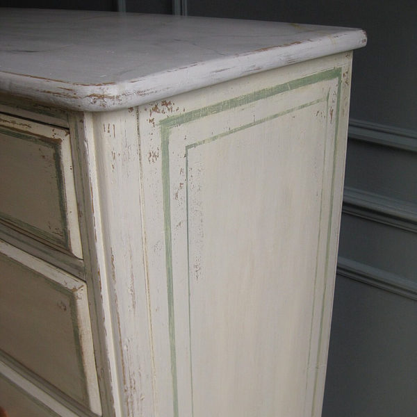 Line detail to side of painted antique chest of drawers