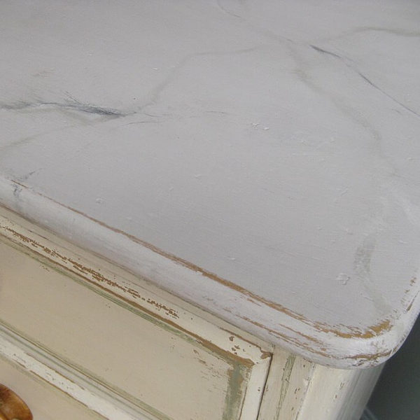 antique chest of drawers with faux marble top