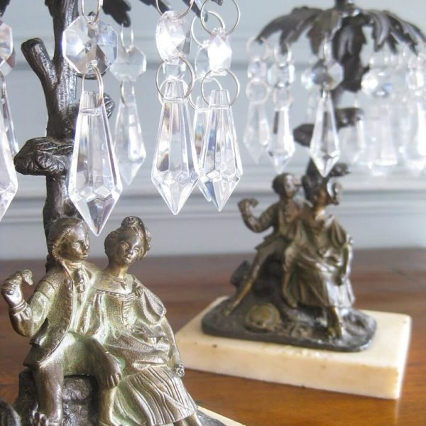 Lustre candlesticks cast as sweethearts
